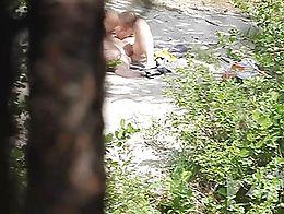Couple filmed by hidden camera at nude beach.