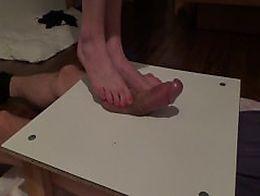 Bare feet massaging big cock