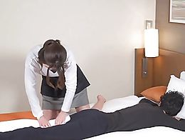 Japanese man with permed hair receives an appointment by a cute hotel massage therapist and cov...