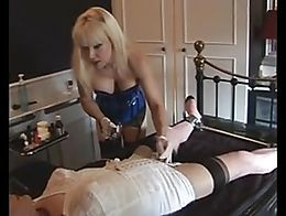 Sissy in bondage and lingerie is shaved by a lovely Mistress while his butt is plugged and his ...