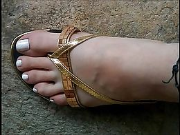 24 years old greek lady, shoe size 37 in europe. Her long toes and her smooth soles need massiv...