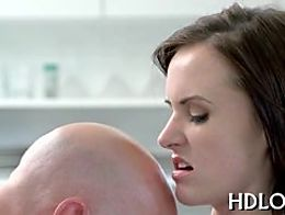 Two naughty beauties are licking studs shaft simultaneously