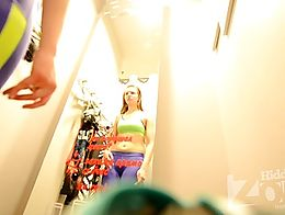 Peeping into the fitting room in the store.