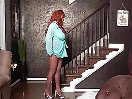 She makes an entrance and wearing only a skimpy, sheer robe and sexy, shiny pantyhose. Looks sh...