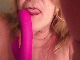 Auntie Sue sucks her toy and plays with her tit