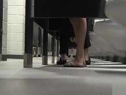 Beautiful feet in all kinds of shoes stroll into the WC to go potty as a camera on the ground f...