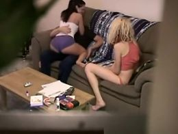 Hidden camera catches one lucky guy in a threesome with two tight body chicks in the couch.