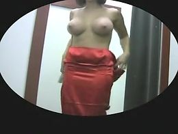 busty girl changing and trying on dresses showing huge boobs