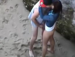 U not at any time know who's watching from a spycam, as this pair is caught, on the beach,...