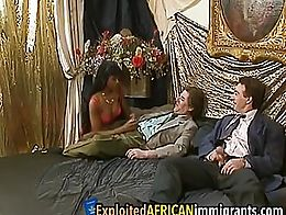 African hottie seduced two white studs into having some fun. She enjoys blowing their long bone...