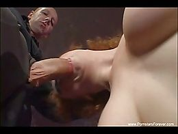 A customer brings out his fat cock and Audrey suck it like crazy. Another guy came in and join ...