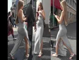 Seductive stunner was walking down the street hand in hand with her boyfriend while wearing a d...