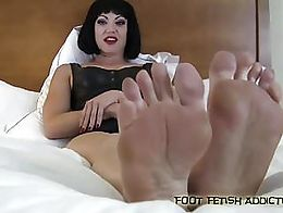 You like my feet? I see it's getting that cock of yours really hard. You'd love to just bury yo...