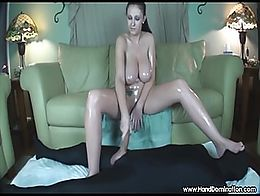 overdeveloped amazon with huge natural tits, giant feet gives an oil soaked handjob
