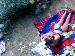 She is on a blanket chatting with her friends while the spy camera stares down at her ass in a ...