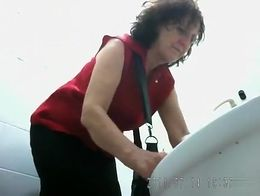 There's a spycam in this WC and it has captured hot video of mature women pissing. They all d...