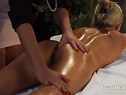 Young obedient slave with hands cuffed gets her body oiled and prepared for sensual night with ...