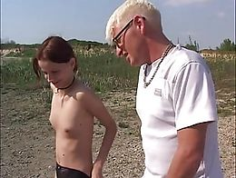 Young skinny german redhead teen slut fucked outdoors on a lake by an older dude. He pisses on ...