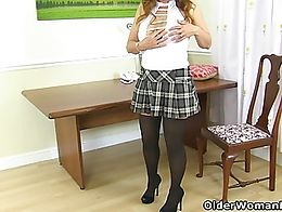 English milf Gemma Gold destroys her nylon tights and fingers her arse on the desk.