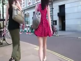 He follows the girls with his camera and when the wind blows up their skirts he films their pre...