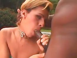 A cute tranny has sex with a black stallion with a big cock.