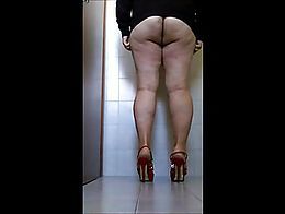Antonella in silence take a short and soft self spanking in a public bathroom. The ass and legs...