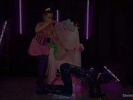 Bella Rossi is a latex plastic princess who loves tormenting her slave. He worships her ass. Sh...