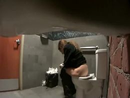 Numerous ladies come through the bathroom and piss in the spycam video. It's shot from the si...
