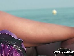 A thrilling nude beach voyeur spy cam video