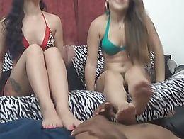 Teens Kandii Kiss and Kandy Kreme barefoot trample their slave. He grunts underneath their body...