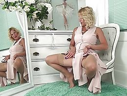 Her fingers are soon working overtime as this lusty granny pulls her thong aside and goes to wo...