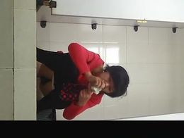 Spy camera in japanese public toilet catches asian woman with short hair squatting and peeing.