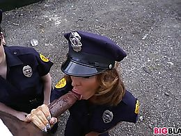 White cops Lyla Lali and Norah Gold suck a big black cock in the streets of Miami