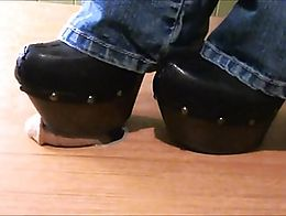 these clogs have a very high sharp heel and rock hard soles perfect for cock trample!