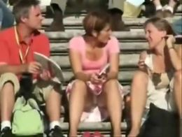Amateur girls in skirts are filmed as they relax in a public square and so many offer upskirt v...