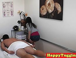 Asian handjob masseuse tugs before riding clients cock