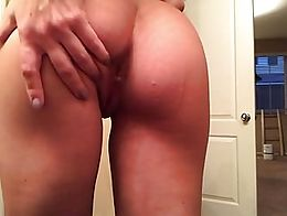 short and sweet clip of girl fucking her asshole with a dildo