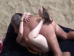 Old man spied in beach fucking his wife missionary style with man near them watching.