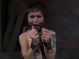 Asian piece of sh*t slut gets bound and gagged in metal and whipped on her feet and body.