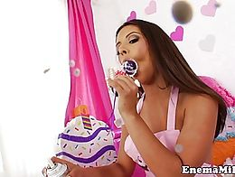 Analfucked enema babe squirting cream after stuffing beads up ass