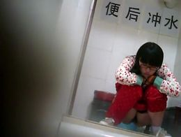 This geeky chinese girl got caught by a hidden camera while pissing in the public toilet and it...