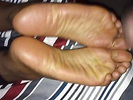 Cumshot on my black girlfriends sexy wrinkled soles!