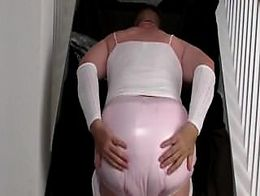 Diapered sissybaby in choker chastity