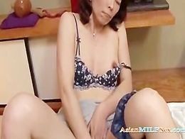 MILF With Hairy Pussy Fingering Herself On The Floor In The Roo