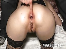 Extreme amateur slut fisted and fucked in her gaping ass with a huge wine bottle