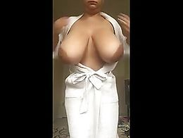 latina in her robe putting on a titty show for our viewing pleasures and she needed was some oi...