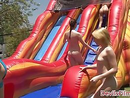 Stunning lesbian babes riding toys in outdoor WAM sexparty