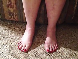 Sitting in front of her recording her feet while we talk about her pretty red nail polish.