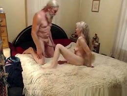 Skinny granny woman waits in bed for her man to come and begins kissing him. She sucks on his c...