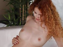 She smiles and undoes her bra to free up her ample breasts, and slides a hand inside her sheer ...